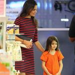 Suri Cruise sulks as Katie Holmes tells her she can't get a puppy at the pet store in NYC 120611