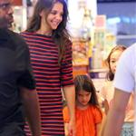 Suri Cruise sulks as Katie Holmes tells her she can't get a puppy at the pet store in NYC 120612