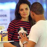 Suri Cruise sulks as Katie Holmes tells her she can't get a puppy at the pet store in NYC 120614