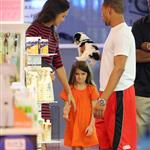 Suri Cruise sulks as Katie Holmes tells her she can't get a puppy at the pet store in NYC 120615
