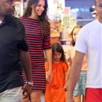 Suri Cruise sulks as Katie Holmes tells her she can't get a puppy at the pet store in NYC 120616