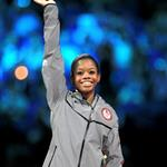 Gabrielle Douglas of the United States celebrates after winning the gold medal in the Artistic Gymnastics Women's Individual All-Around final on Day 6 of the London 2012 Olympic Games 122356