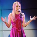 Kristen Bell performs at the 20th Anniversary Alzheimer's Association 'A Night at Sardi's' at The Beverly Hilton Hotel 109841