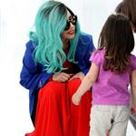 Lady Gaga greets a young fan as she leaves Toronto 87944