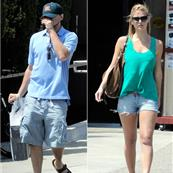 Leo and Bar leave a camera shop in LA 62366