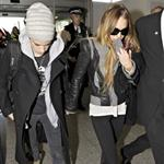 Lindsay Lohan and Samantha Ronson holding hands at Heathrow after fighting over Calum Best 27798