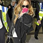 Lindsay Lohan and Samantha Ronson holding hands at Heathrow after fighting over Calum Best 27797