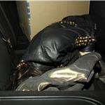 Lindsay Lohan hiding in the back of a car 57994