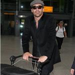 Jon Hamm and partner Jennifer Westfeldt arriving at Heathrow 68265