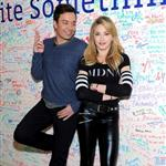 Jimmy Fallon and Madonna sign the Facebook wall before their livestream interview at the Facebook offices in New York 109737
