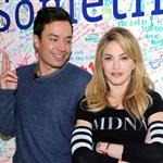 Jimmy Fallon and Madonna sign the Facebook wall before their livestream interview at the Facebook offices in New York 109740