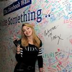Jimmy Fallon and Madonna sign the Facebook wall before their livestream interview at the Facebook offices in New York 109741