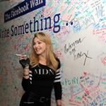 Jimmy Fallon and Madonna sign the Facebook wall before their livestream interview at the Facebook offices in New York 109742