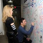Jimmy Fallon and Madonna sign the Facebook wall before their livestream interview at the Facebook offices in New York 109748