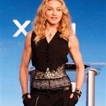 Madonna speaks at the podium during a press conference for the Bridgestone Super Bowl XLVI halftime show 104741