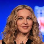 Madonna speaks at the podium during a press conference for the Bridgestone Super Bowl XLVI halftime show 104742