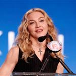 Madonna speaks at the podium during a press conference for the Bridgestone Super Bowl XLVI halftime show 104743