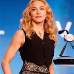 Madonna speaks at the podium during a press conference for the Bridgestone Super Bowl XLVI halftime show 104744