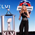 Madonna speaks at the podium during a press conference for the Bridgestone Super Bowl XLVI halftime show 104746