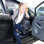 Miley Cyrus seen with her engagement ring at LAX 116858