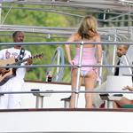Eddie Murphy in St Barts on a yacht serenading two ladies with his guitar 29842