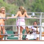 Eddie Murphy in St Barts on a yacht serenading two ladies with his guitar 29835