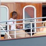 Eddie Murphy in St Barts on a yacht serenading two ladies with his guitar 29836