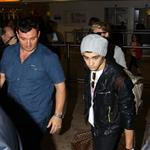 Zayn Malik of One Direction arrives at Heathrow Airport 112254