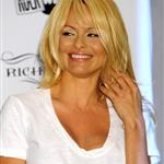 Pamela Anderson looks like she's had a touch up on her face at Richie Rich fashion show in Miami 35774