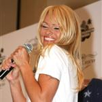 Pamela Anderson looks like she's had a touch up on her face at Richie Rich fashion show in Miami 35775