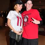 Paris Hilton poses with a douchebag in Tampa Bay for Super Bowl 31861