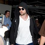 Robert Pattinson has a lot of baggage at LAX  97470