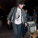 Robert Pattinson's pants make his thighs touch at LAX  101480
