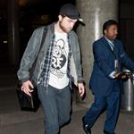 Robert Pattinson's pants make his thighs touch at LAX  101485