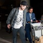 Robert Pattinson's pants make his thighs touch at LAX  101486