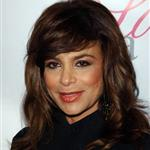 Paula Abdul has an animal on her head 19348