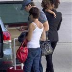 Penelope Cruz and Javier Bardem with their son Leo at the Madrid Airport 117465