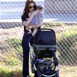 Victoria Beckham with a chubby Harper Seven watching sons at football  97391