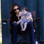 Victoria Beckham with a chubby Harper Seven watching sons at football  97396