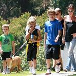Victoria Beckham flipflops ponytail bulldog at basketball with her kids  67113