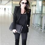 Pregnant Victoria Beckham arrives at Heathrow in black  80958