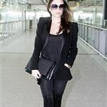 Pregnant Victoria Beckham arrives at Heathrow in black  80962
