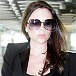 Pregnant Victoria Beckham arrives at Heathrow in black  80964