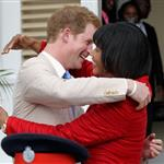 Prince Harry and Prime Minister of Jamaica Portia Simpson-Miller hug on the steps of Devon House in Kingston, Jamaica 108249