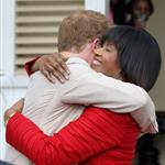 Prince Harry and Prime Minister of Jamaica Portia Simpson-Miller hug on the steps of Devon House in Kingston, Jamaica 108250