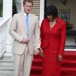 Prince Harry and Prime Minister of Jamaica Portia Simpson-Miller hug on the steps of Devon House in Kingston, Jamaica 108252