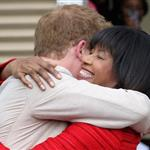 Prince Harry and Prime Minister of Jamaica Portia Simpson-Miller hug on the steps of Devon House in Kingston, Jamaica 108254