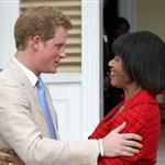 Prince Harry and Prime Minister of Jamaica Portia Simpson-Miller hug on the steps of Devon House in Kingston, Jamaica 108256