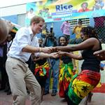 Prince Harry wearing a pair of blue suede shoes shows off his dance moves as he visits the Rise Life Youth Project in Kingston, Jamaica and meets Rita Marley widow of Reggae legend Bob Marley 108264