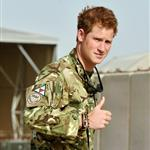 Prince Harry is shown the Apache flight-line by a member of his squadron at Camp Bastion in Helmand Province, Afghanistan where he has been redeployed  125441